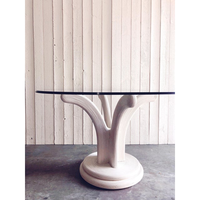 Sculptural, fanned, white pencil reed dining table base in the style of Gabriella Crespi. Perfect for a round or round...
