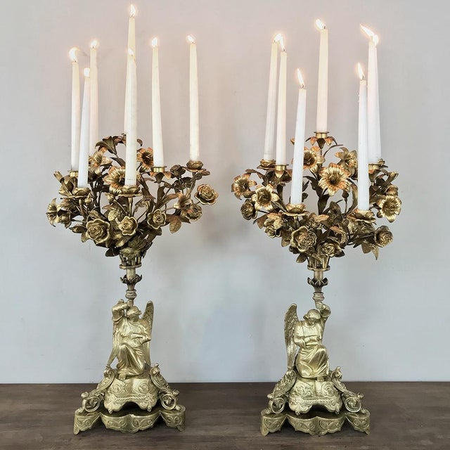 Pair 19th Century Bronze Candlesticks with Angels hail from the Napoleon III Period, and feature stunning angels on...