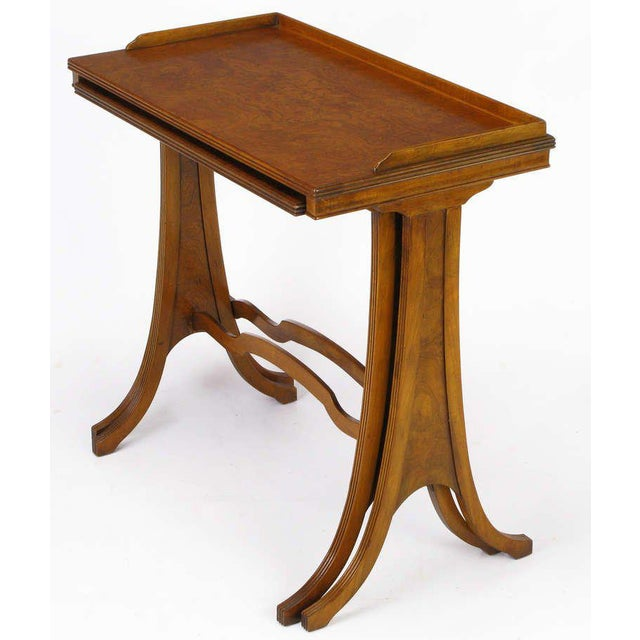 Burled walnut pair of nesting side tables by Baker Furniture, with a hint of Art Nouveau. Larger table has a distinctive...