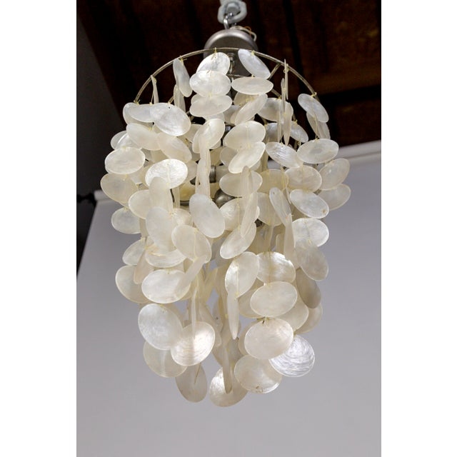 This distinctly fine capiz shell pendant light casts a beautiful glow. It's delicate, pearlescent appearance looks...