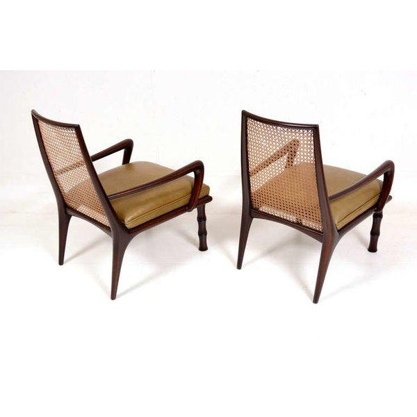 For your consideration a pair of lounge chairs attributed to Eugenio Escudero. Beautiful sculptural design in solid...