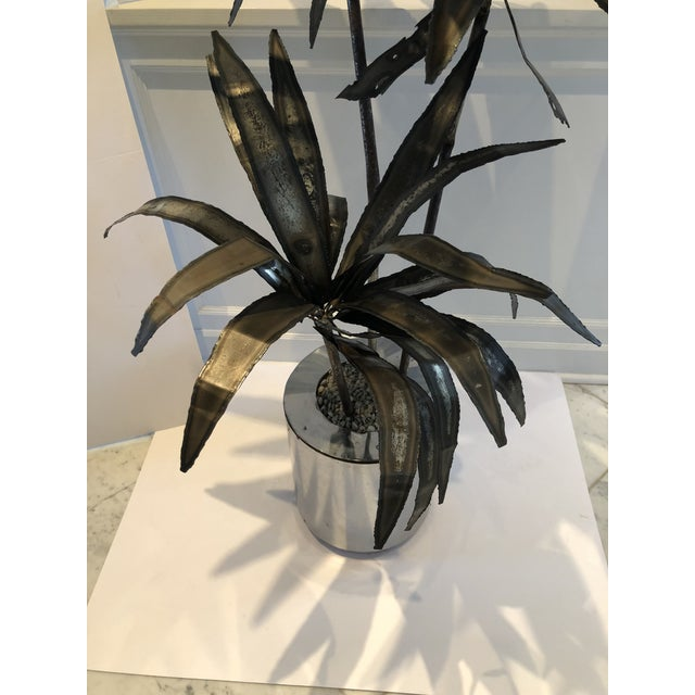 A super cool torch-cut sculpture of a palm tree in pot with pebbled mulch. Definitely mid-century, I am unsure of the...