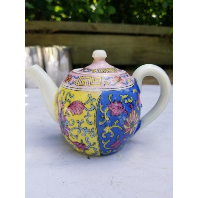 Beautiful pastel shades in a distinctly oriental design mark this unique little teapot that has had quite a journey. It...