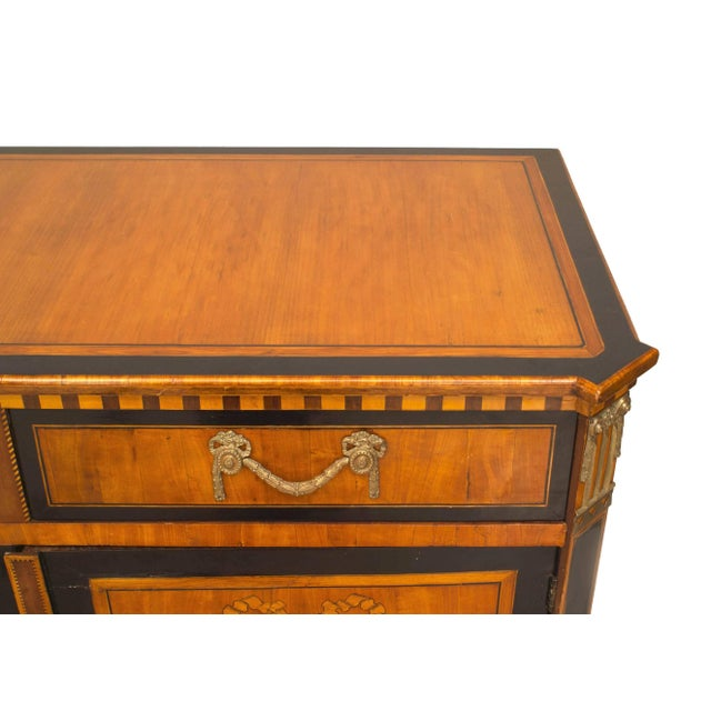 Continental Dutch satinwood commode cabinet with two drawers above to doors with floral marquetry panels (18th-19th century).