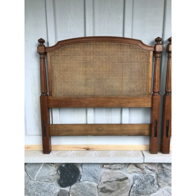 Pair of twin headboards and metal frames made by Kindel. Cane and walnut with fluted sides. Would complement any mid...