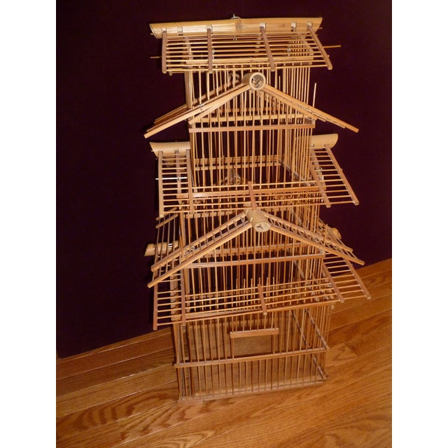 At just over two feet, and featuring five tiers, this Mid-century Modern, 1970s-era bird cage is worthy of a tweet! This...