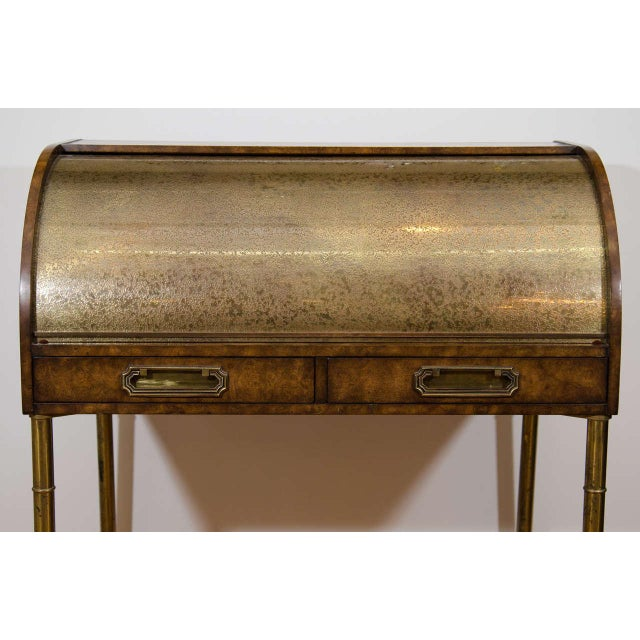 Mastercraft Amboyna burl wood and etched brass roll top desk with brass bamboo legs. The piece has two drawers, several...
