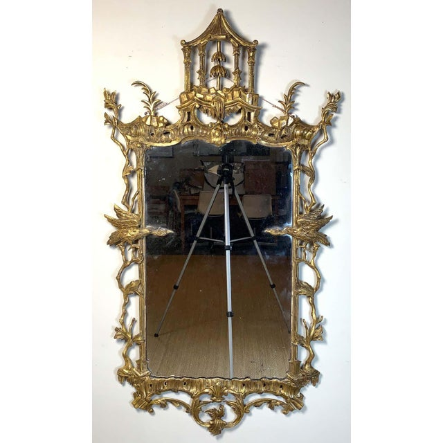 A fine mid-18th century. Geo. II Chinese Chippendale giltwood wall mirror. The rectangular plate surmounted by a pagoda...