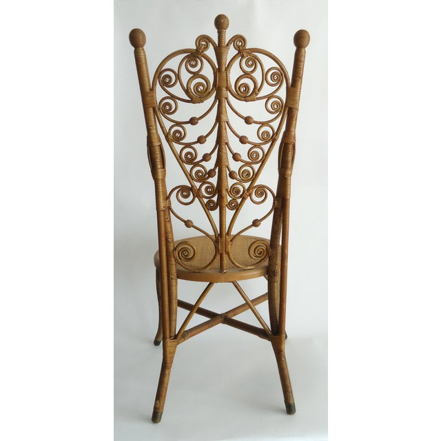 A Victorian era fancy wicker chair by Heywood Wakefield, this sort of chair were generally used in photographer's studios...