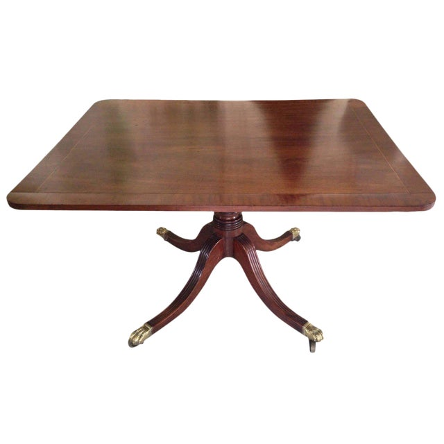 English Georgian Tilt-Top Mahogany Supper Table with Brass Lion's Paw Feet For Sale