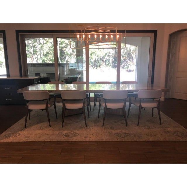 Brand New showroom floor set. Table includes double base, table top, and 2 leaves. Dyed gray Makore veneers and features a...