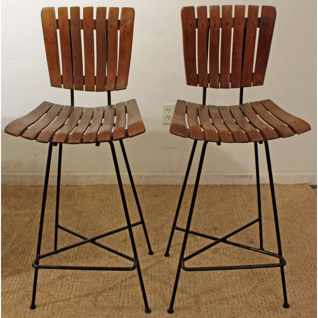 Offered is a mid-century modern 3-piece bar set designed by Arthur Umanoff. Includes two slat stools and dry bar. The bar...