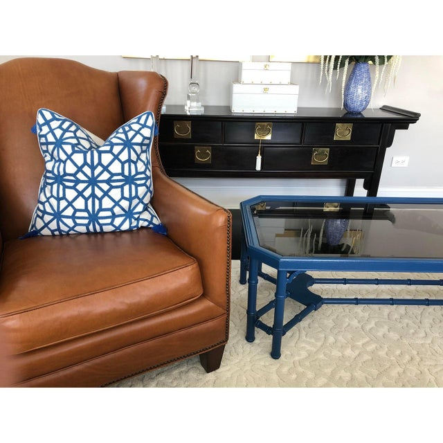 Offered is a vintage solid wood coffee table with bamboo details. This piece features a painted blue frame and tinted...