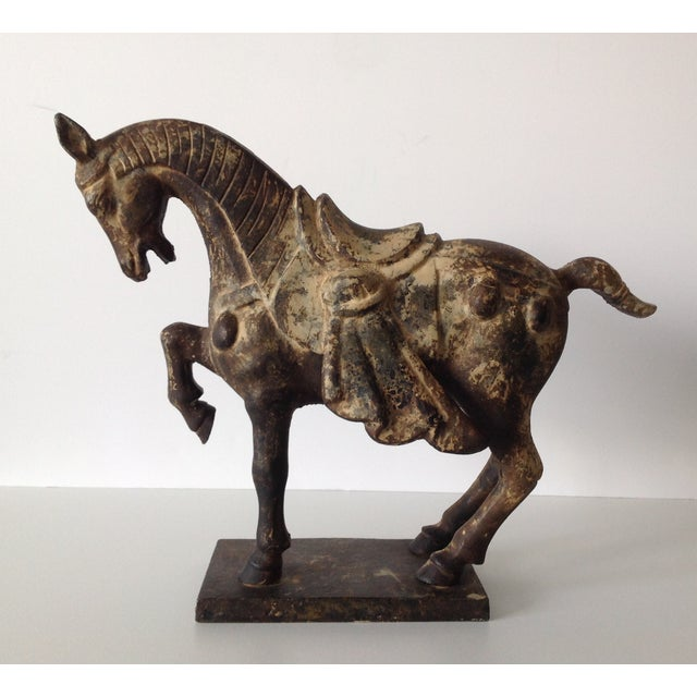 Antique 1930-50s Tang-style iron horse with regalia dressage, stylized mane, and raised hoof on a square base. From a...