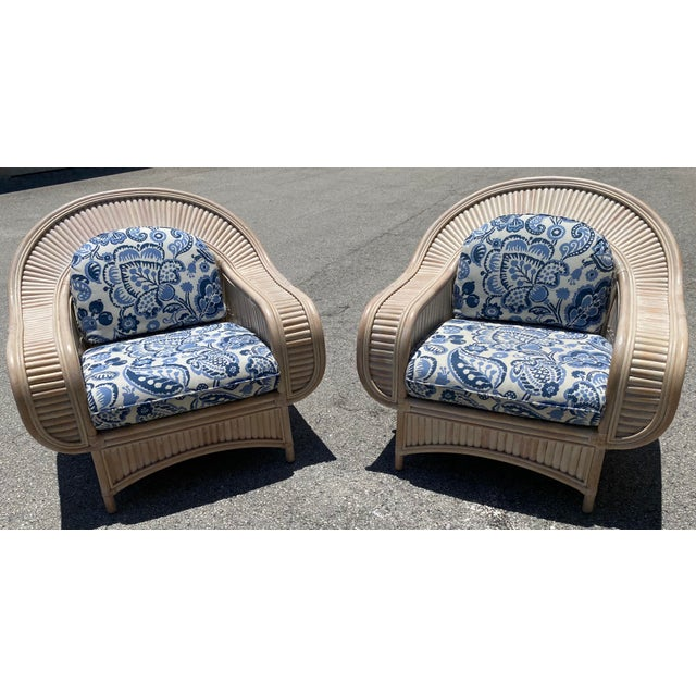 An exquisite pair of bamboo curved lounge chairs, circa 1950. Stout, sturdy and expertly made pieces intended for heavy...