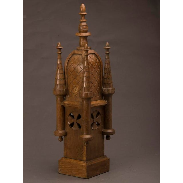 An elaborate small scale model of a medieval tower with four turrets carved of solid wood from France c. 1870 highlighted...