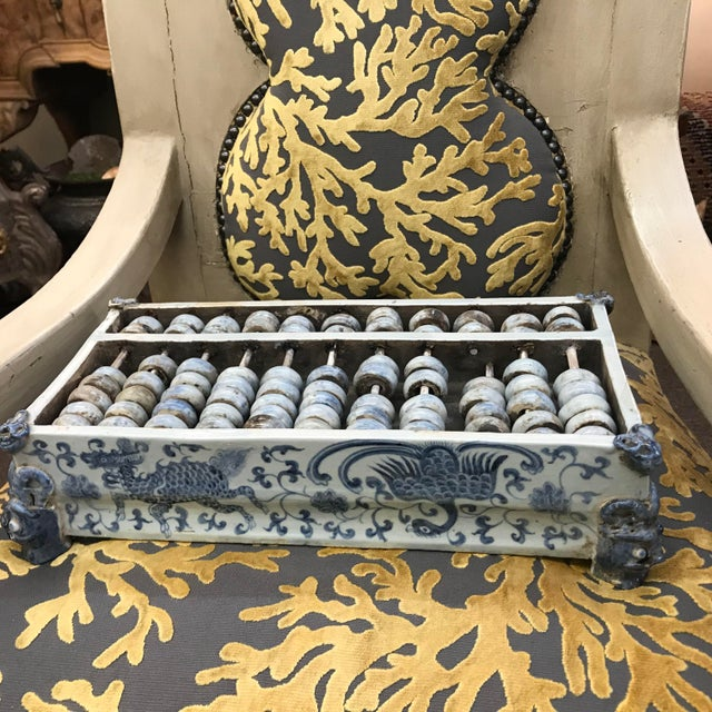 Antique Chinese abacus with blue and white porcelain with dragons, birds and scrolls. Corners with faces.