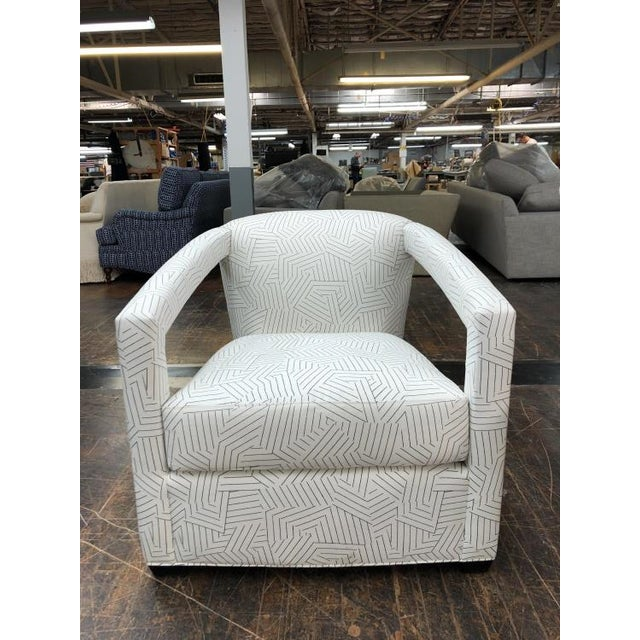 The Calla Chair is a first quality sample that features a Black & White patterned fabric (30364-86) with a Melange finish....