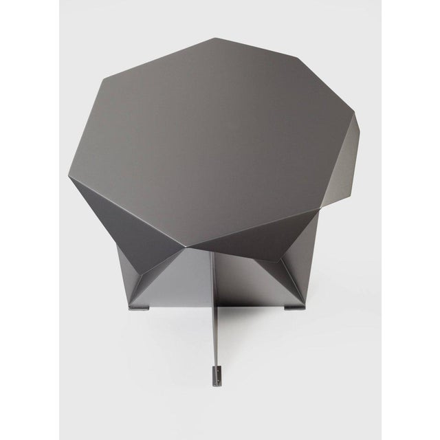 A very sculptural powder-coated steel table in high end quality. Production will take 9-10 weeks to make this piece.
