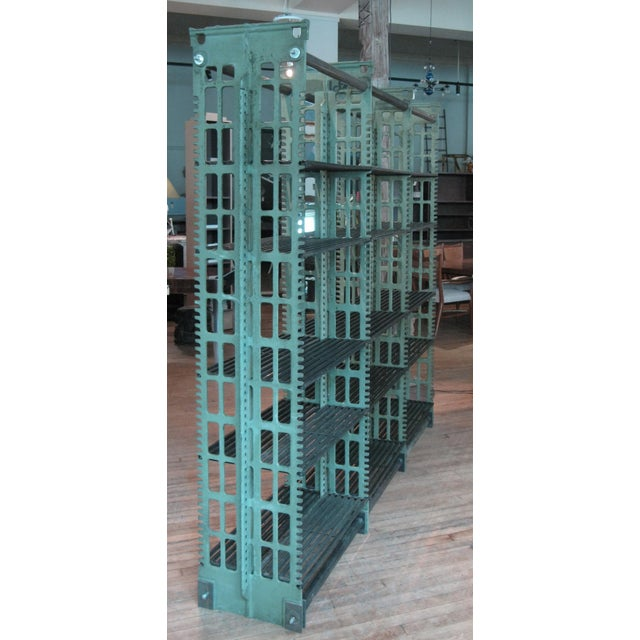 A rare set of antique cast iron archival library bookcases by Snead. these impressive cast iron bookcases with adjustable...
