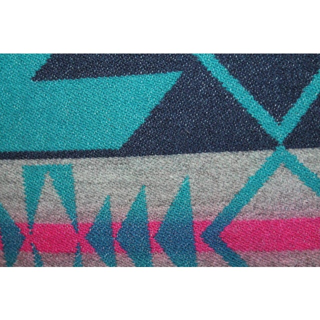 These colorful wool blanket pillows have blue cotton linen backing. They were made from an Indian design camp blanket with...