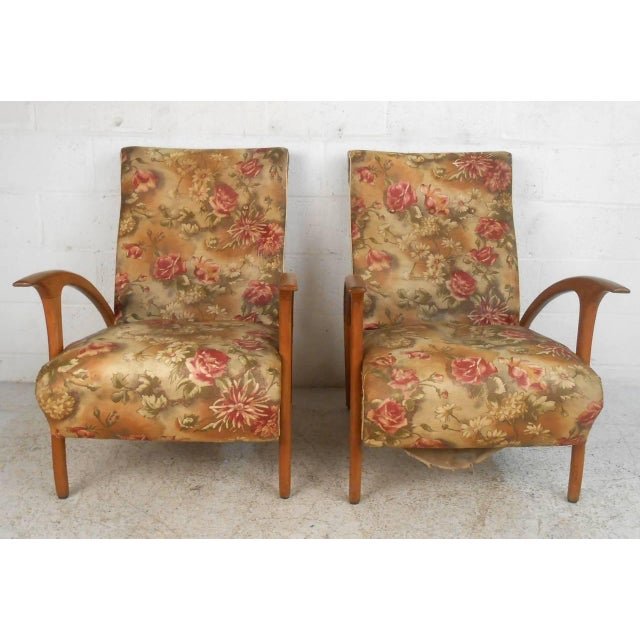 This unique pair of lounge chairs combine style and comfort, featuring wide slightly reclining seat backs, sculpted...