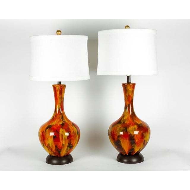 Vintage pair of porcelain table or task lamps with brass base. Each lamp is in excellent working condition. Each one...