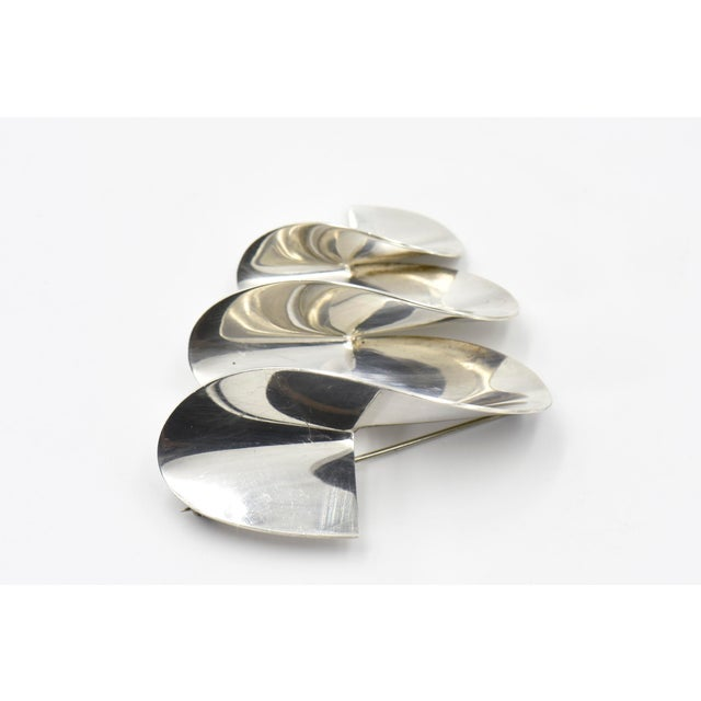 Modernist Mexican sterling silver 3d brooch pin gives the illusion of movement. A great statement piece. Marked Mexico 925...