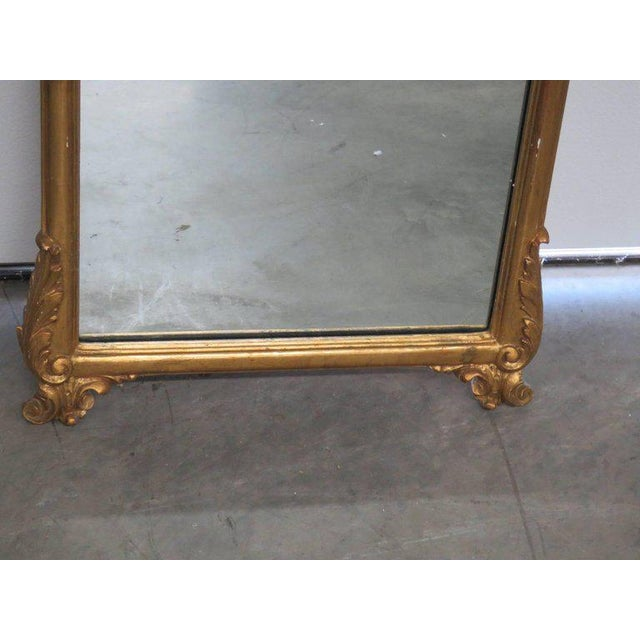Friedman Brothers Victorian style hall mirror with a gilt frame.