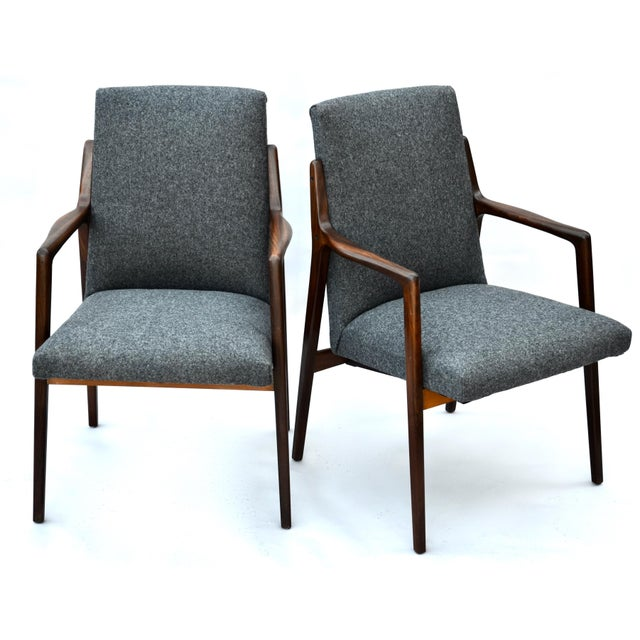 A sharp pair of Danish highback Mid Century modern walnut chairs in newly upholstered gray wool. A nice sculpted deep walnut.