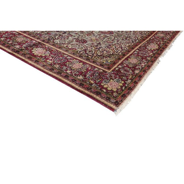 Renowned for soft, extremely luxurious silk, this late 19th century antique Persian Kashan rug is highly prized with its...