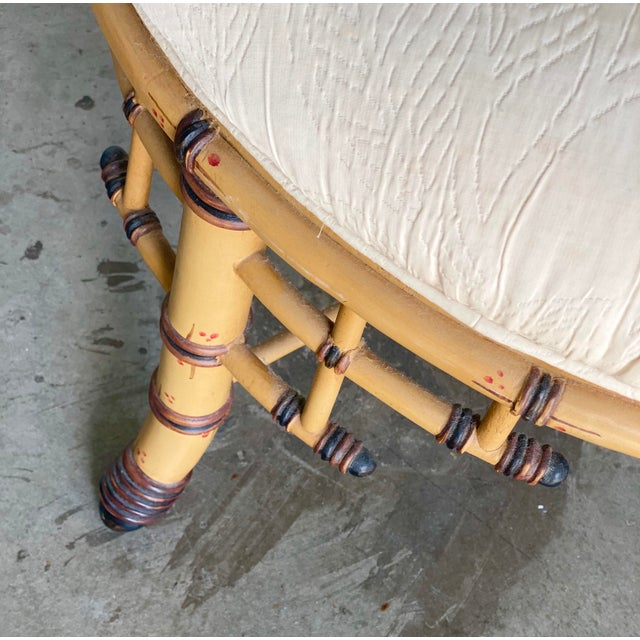 Fabulous Bamboo arm chair. Gorgeous fret work detail and a cane seat. The chair is a soft gold with brown detail. Acquired...