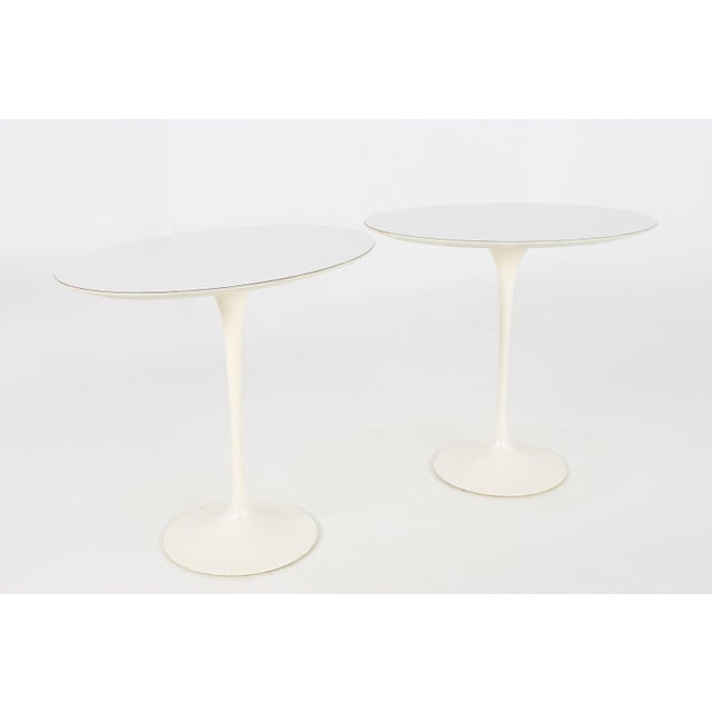 Eero Saarinen for Knoll Mid Century Modern oval tulip side tables. Each side table measures 22.5 wide x 15 deep x 20.5...