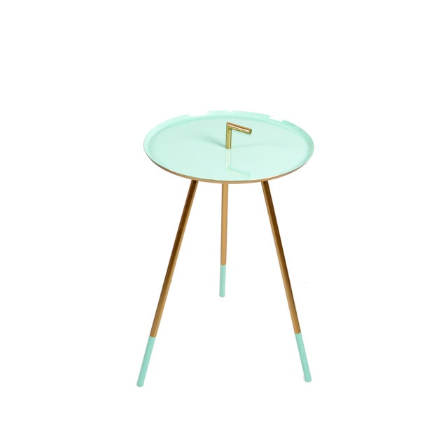 Stylish 1950s Italian side or end table on three legs in polished brass. The Top has a Finish in turquoise enamel....