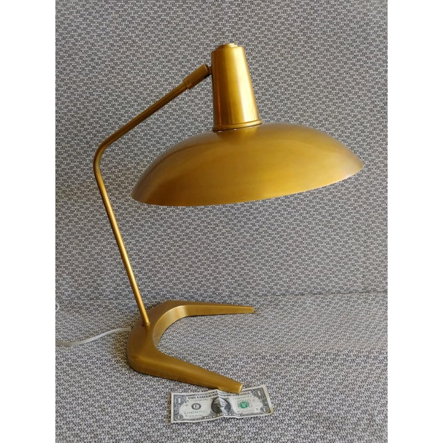 High quality brass mid-century modern desk lamp from Robert Abbey. Shade is fully adjustable. Lamp is barely used,...