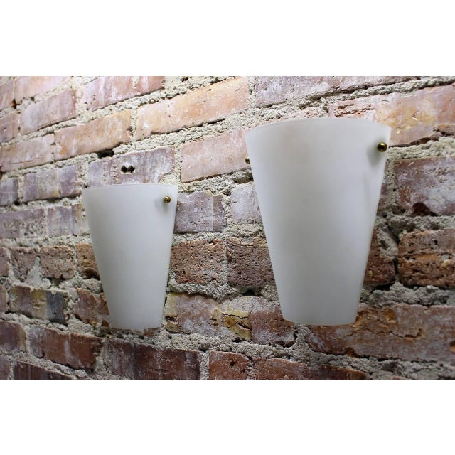 A pair of wall sconces in style of Stilnovo.