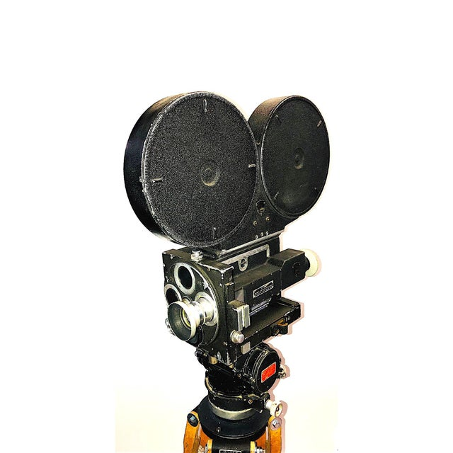 Offered for your consideration is this Circa 1949 Mitchell prop / display camera on vintage wood legs and tripod head....