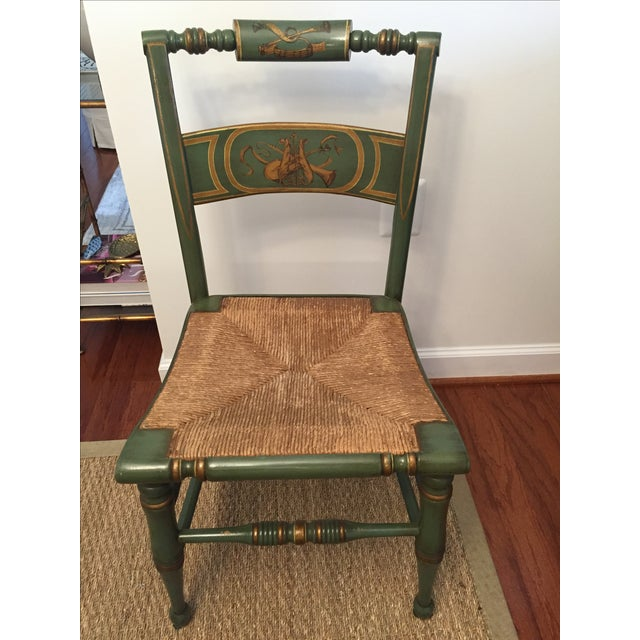 Lambert Hitchcock created the first chairs to bear his name in the 1820s. This set of 4 chairs has painted flutes and...