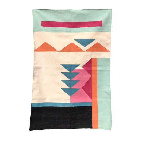This geometric area rug has been ethically hand woven in the finest cotton yarns by artisans in Rajasthan, India, using a...