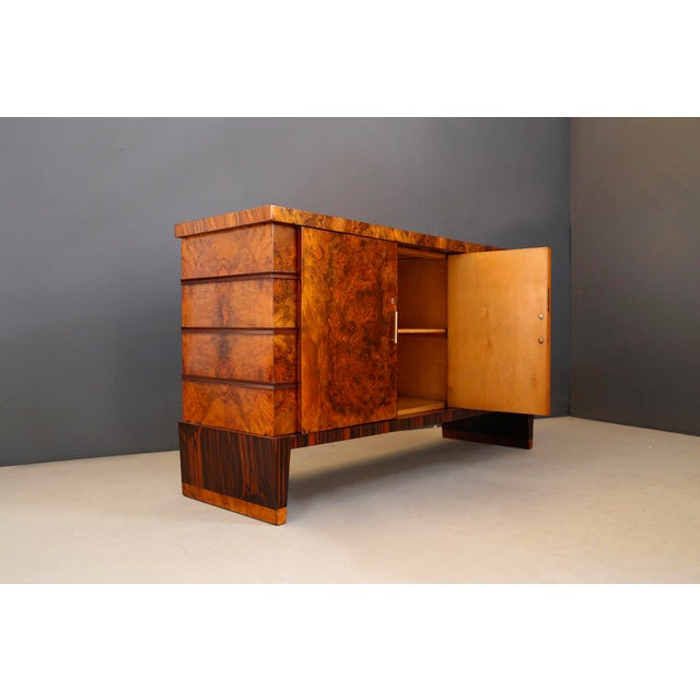 Elegant sideboard attributed to Italian designer Gio Ponti. The sideboard is in walnut wood. The sideboard is made with...