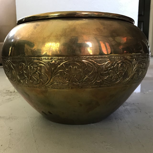 A beautiful embossed brass planter pot in excellent condition. Would be beautiful holding orchids.