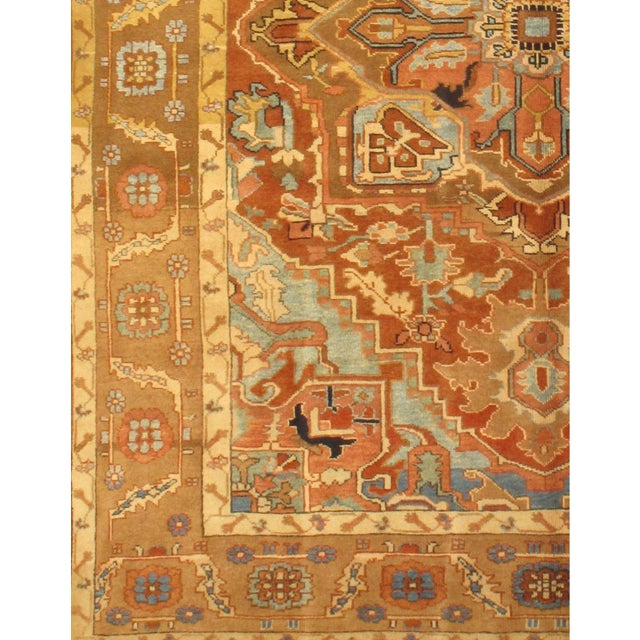 Hand-knotted Heriz rug. This rug features 100% fine pure lambs wool, hand-knotted into elegant designs, perfect for your...