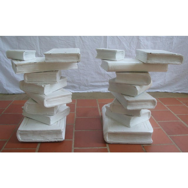 Fabulous pair of matching painted wood trompe l'oeil stacked books which could be used in a number of ways. Use each...