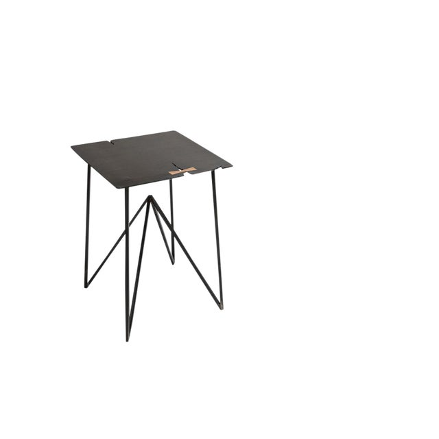 Hewed from 1/4 blackened steel with solid wood details, the Steel Forest Side is a statement piece for your space. The...