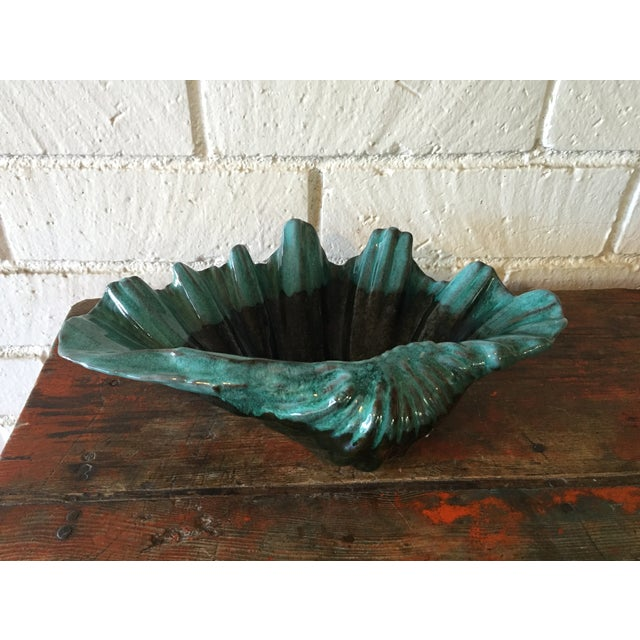 "Large drip glazed display bowl in aqua and very dark gray. Footed bottom and marked ""Evangeline, 975"". Two small chips on..."