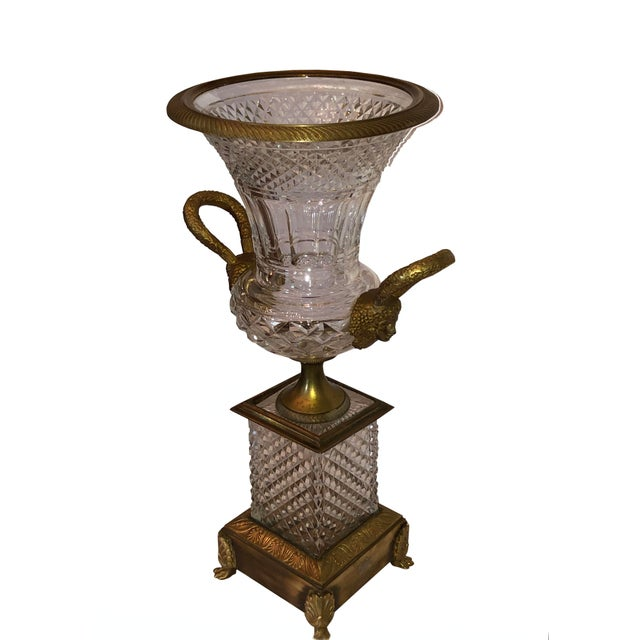 A French crystal and bronze urn by Baccarat, circa 1900. Lovely carved crystal and detailed handles with faces.