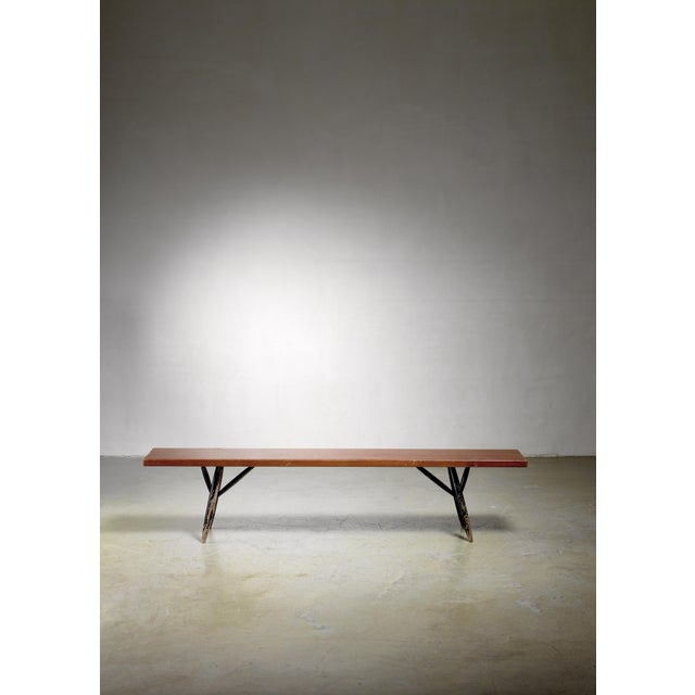 A long model Pirkka bench by Ilmari Tapiovaara for Laukaan Puu. The bench is made of stained pine with black lacquered...