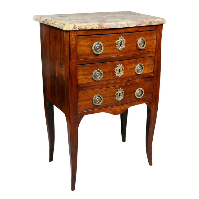 With original Breche De Alep serpentine marble top over three drawers with ring handles and conforming backplates raised...