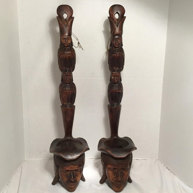 A stunning wooden set of south East Asian folk art pieces. The wooden faces show the age appropriate wear including...