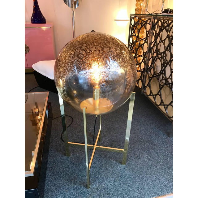 Impressive and very decorative floor lamps or huge table lamps by the editor La Murrina Murano. Blown glass sphere with...
